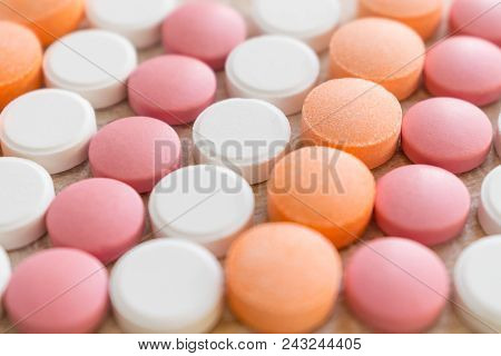 White, Pink And Orange Tablets Stripes Background. Different Antacids Medications Help Neutralize St