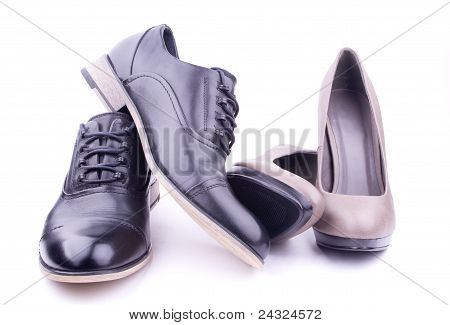 A pair of men's and women's shoes