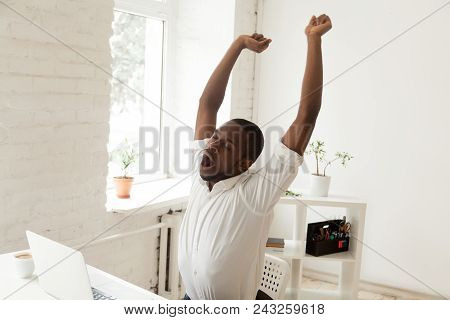 Tired Funny Male African American Person Yawning And Stretching In Office Chair, Feeling Tired After