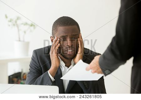 Frustrated Upset African American Worker Getting Dismissal Notice, Looking Sad And In Low Spirits Be