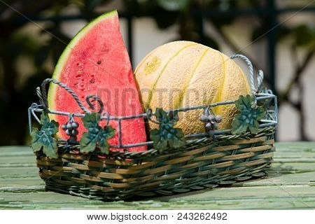Seasonal Fresh Fruits, Watermelon And Rockmelon In Basket On Table Top, Outdoor