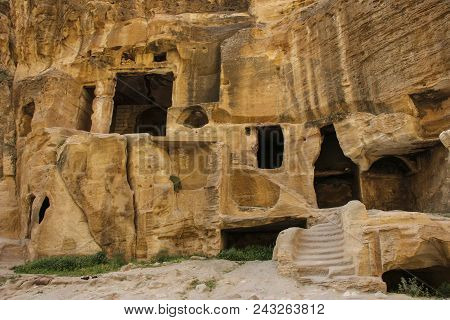 Little Petra in Siq al-Barid, Wadi Musa, Jordan. The architectural ensemble Little Petra is the temples cut in the rocks, altars, stairs, rooms, ritual rooms poster