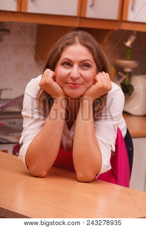 Vision And Idea Concept. Happy Dreaming Thinking Woman In Kitchen. Contemplating Housewife Wearing P
