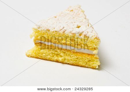 Side Of The Triangle Of Sponge Cookie With Skimming Filling