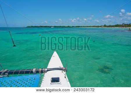 Sailing Yacht Catamaran Sails On The Waves In The Warm Caribbean Sea. Sailboat. Sailing. Cancun Mexi