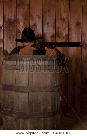 Cowboy Shooting Over A Barrel