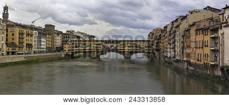 Panoramic View Of Arno River And Ponte Vecchio Bridge In Florence, Italy.