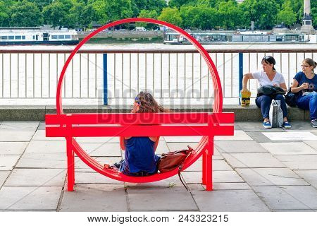 London, Uk - August 7, 2017 - Tourist Sitting On One Of Modified Social Benches By Jeppe Hein Displa