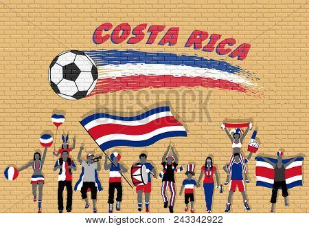 Costa Rican Football Fans Cheering With Costa Rica Flag Colors In Front Of Soccer Ball Graffiti. All