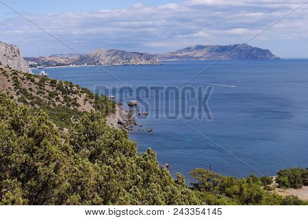 A Delightful Landscape On The Sea Bay Located Between The Slopes Of The Mountains