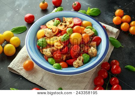 Panzanella Tomato Salad With Red, Yellow, Orange Cherry Tomatoes, Capers, Basil And Ciabatta Crouton