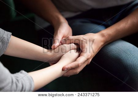Close Up View Of Couple Holding Hands, Loving Caring Man Supporting Comforting Woman, Giving Psychol