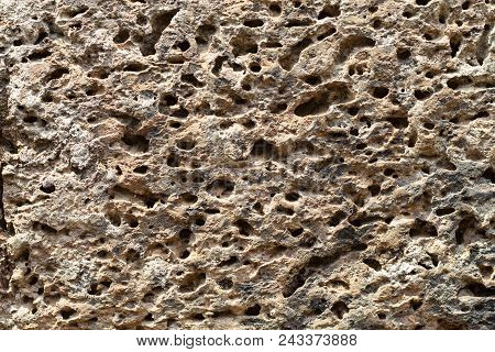 Yellow Porous Stone Texture Photo. Natural Stone Background. Weathered Rock Relief. Old Grunge Stone