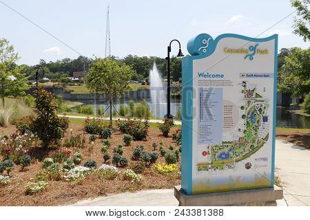 Tallahassee, Fl, Usa - May 13, 2018: Cascades Park Entrance Sign And Landscape.view Of Cascades Park