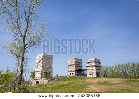 Horizontal Image Of Three Tall Old Abandoned Brick Limestone Kilns Sitting On A Hill In The Summer T