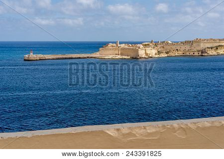 Photo Of Stone Stairs And Wall With Metal Rail In The Ancient Center Of Valletta, Malta. Blue, Cloud