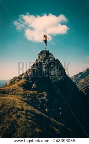 Hiker Celebrating Success On Top Of A Mountain.