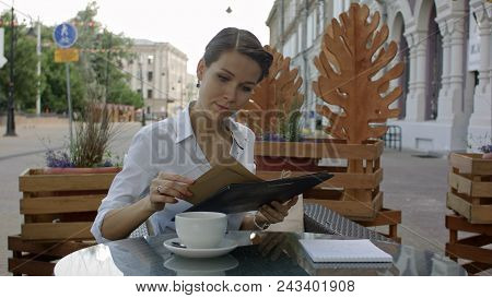 Women In Cafe Reading Menu Professional Shot On Bmcc Raw