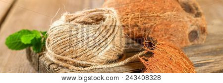 Rope Of Fiber Coir And Coconut Shell On An Old Wooden Table