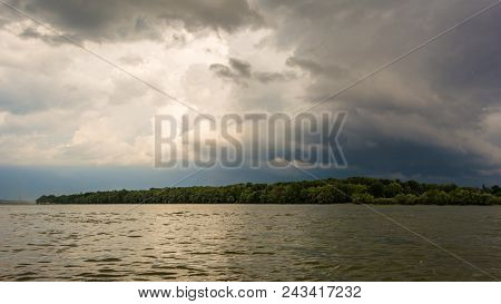 Dark Storm Clouds With Background. Dark Clouds Before A Thunder-storm At Riverside Of Danube