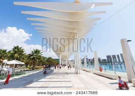 Malaga, Spain - September 8, 2015: People Walk Under The Designer Sunshade Runnind Wave In Sunny Aut