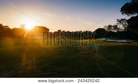 Deliberate Sunflares. Cinematic View Of Empty Golden-lit Golf Course In Algarve, Southern Portugal.