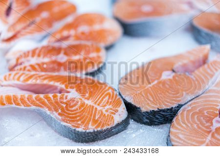 Lots Of Fresh Raw Salmon Steaks On Ice In Supermarket. Fresh Raw Salmon On Ice. Big Pieces Raw Salmo