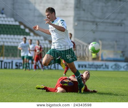 KAPOSVAR, HUNGARY - SEPTEMBER 24: Gabor Janvari (in white) in action at a Hungarian National Championship soccer game - Kaposvar (white) vs Debrecen (red) on September 24, 2011 in Kaposvar, Hungary.