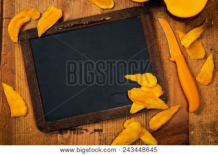 Dried Mango Fruit. Education Chalkboard Background Concept With Copy Space. Selective Focus.
