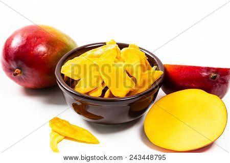 Dried Mango Fruit On White Background. Selective Focus.