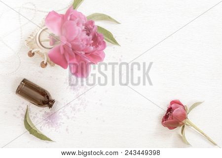Bottle Of Essential Oil Spa Theme Objects With Fresh Peony Flowers Aged Photo Old Photo Effect. Sele