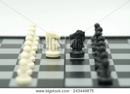 Chessboard With A Chess Piece On The Back Negotiating In Business. As Background Business Concept An