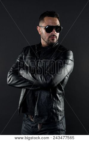 Confident Man Stand With Arms Folded. Bearded Man In Trendy Sunglasses. Fashion Model In Leather Jac