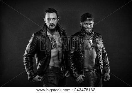 Leather Masculine Clothing Concept. Men With Sexy Muscular Torsos Look Brutally. Machos With Muscula