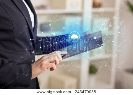 Business woman using tablet with financial, cloud connectivity concept