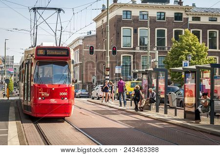 The Hague (den Haag), Netherlands. July 19, 2017. Red City Tram In The Downtown Hague With Passenger