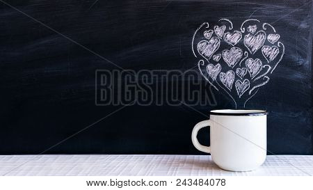 White Metal Enameled Cup And Chalk-drawn Small Hearts In The Form Of A Heart On The Blackboard. Vale