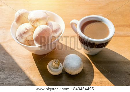 Mushroom Coffee Superfood Trend. Cup Of Coffee And White Bowl With Mushrooms On Wooden Background Wi