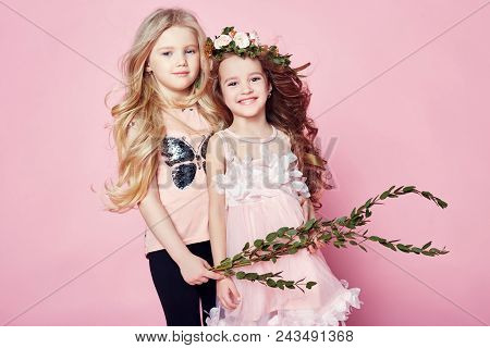 Two Girls Bright Summer Look Beautiful Clothes. Flowers On Head. Girls Have Fun And Cuddle On A Brig