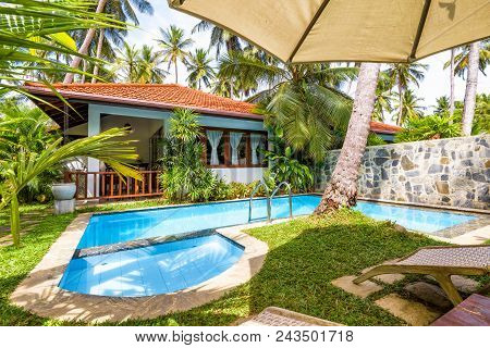 Sri Lanka - October 31, 2017: Pool With Umbrella And Beach Beds In A Tropical Hotel Or House. Pool W