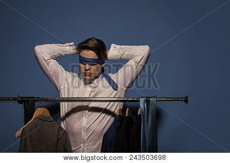 Businessman Tie Eyes With Necktie In Wardrobe On Blue Background. Blindfold Business Concept. Fashio