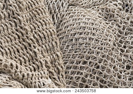 Fishery Nets, Abstract Background Of Old Fishing Nets Light Color.