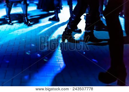 Defocused Background Of A Dance Floor In A Disco Club With People Dancing Under The Disco Ball Blue