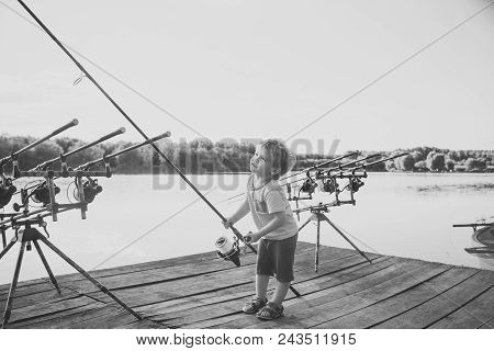 Child Childhood Children Happiness Concept. Angling Child With Fishing Rod On Wooden Pier. Angling,
