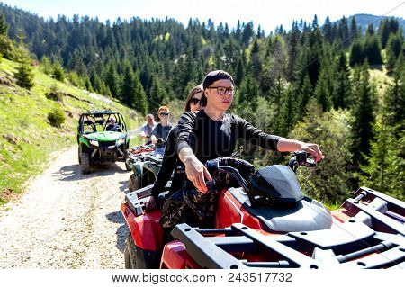 A Tour Group Travels On Atvs And Utvs On The Mountains.