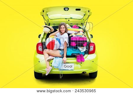 Ready to travel. Woman in Green Overloaded Car with Stuff Things before Trip. Bright Suitcases Luggage Full Stuff Accessories Clothes Ballon. Summer Concept Holiday Adventure Isolated on Yellow poster