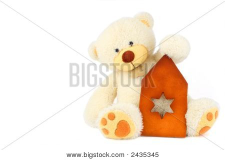 White Teddy Bear And Part Of Gingerbread Hause