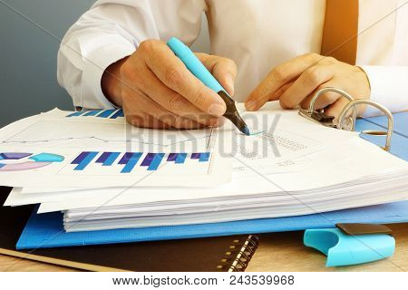 Auditor Is Checking Financial Report. Audit Concept.