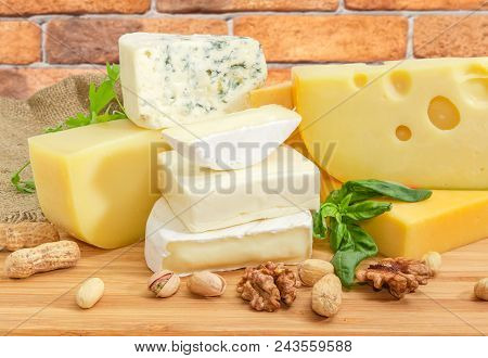 Pile Of Pieces Of Different Soft And Semi-soft Cheese With Mold, Medium-hard And Hard Cheese With Va