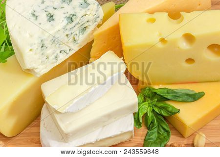 Pile Of Pieces Of Different Soft And Semi-soft Cheese With Mold, Medium-hard And Hard Cheese Closeup
